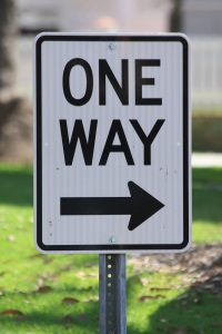 Road sign illustrating one way fees